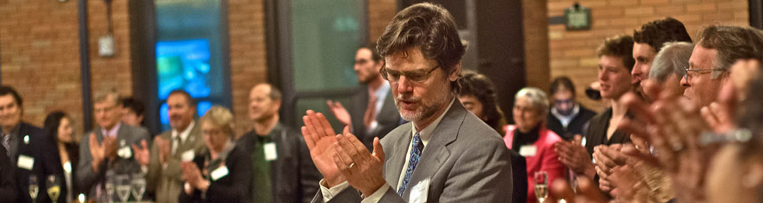 People clapping at a legislative event in Sacramento