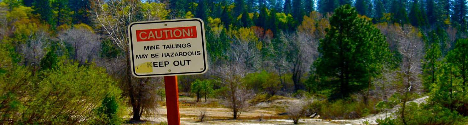 caution sign about mine tailings