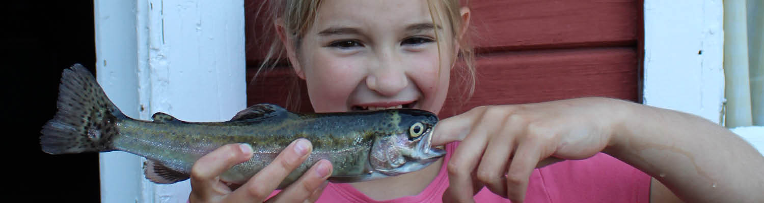 Young person holding a fish